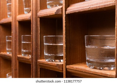 perspective from wooden shelves with glasses for alcohol, shots on shelves