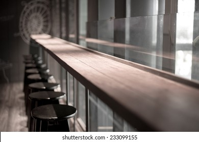 perspective wooden table in bar space