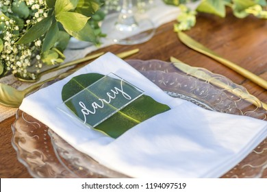 Perspex Romantic Wedding Table Top Layout Table Spread no people no human tropical location with gold cutlery and scenic view