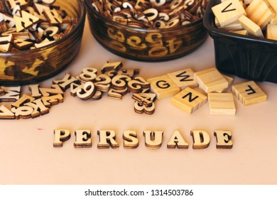 persuade text with small wooden letters
