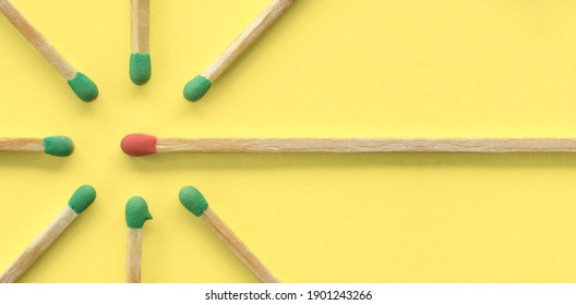 Persuasion, influence, sharing ideas and social network concept. Red matchstick surrounded by green ones, copy space, flat lay, top view.