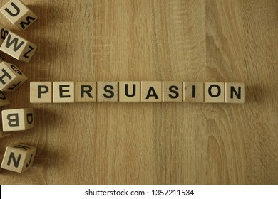Persuasion word from wooden blocks on desk