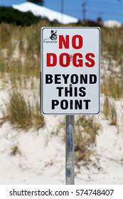 PERTH, AUSTRALIA - 2 MAY 2016: A sign on a beach reads: NO DOGS BEYOND THIS POINT. Dogs are the most common pet with 39% of Australian households owning one equating to 4.2 million pet dogs. Editorial