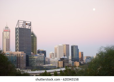 Perth, Australia; April 9, 2017: Regional headquarters of mining companies Woodside, Rio Tinto and BHP Biliton in Perth, capital of Western Australia, at sunset.