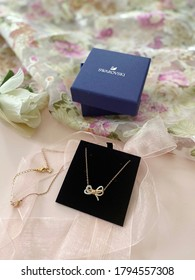 Perth, Australia, August 24, 2018. Swarovski jewellery gold necklace on the gift box. Best give for love one. Top view. Selective focus.