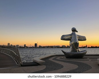 PERTH, AUSTRALIA - FEBRUARY 2018 : Big Penguin in a boat sculpture at Elizabeth Quay in Perth, Australia on February 24, 2018. It represents the arrival of British settlers in 1829.