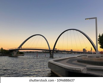 PERTH, AUSTRALIA - FEBRUARY 2018: People walking on Elizabeth Quay pedestrian bridge at Central Business District (CBD) in evening in Perth, Australia on February 24, 2018. It is leaning-arch bridge.