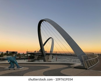 PERTH, AUSTRALIA - FEBRUARY 2018 : People walking on Elizabeth Quay pedestrian bridge at Central Business District (CBD) in evening in Perth, Australia on February 24, 2018. It is leaning-arch bridge