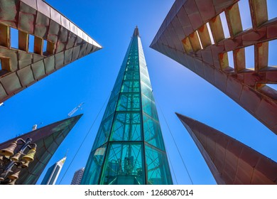 Perth, Australia - Jan 3, 2018: bottom view of iconic glassed tower and tall skyscrapers of Elisabeth Quay in the blue sky. Architecture background. Landmarks in Perth City, Western Australia.