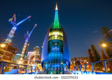 Perth, Australia - Jan 5, 2018: Bell Tower or Swan Bell Tower and construction cranes illuminated by night lights in Perth city, Western Australia. The Barrack Square area is still under construction.