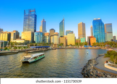 Perth, Australia - Jan 6, 2018: turistic ferry in Elizabeth Quay Marina at sunset with skyscrapers of Central Business District on background in Perth, Western Australia.
