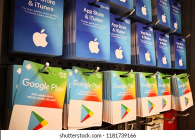 PERTH, AUSTRALIA - JUNE 11, 2018 : Apple App Store and Google play gift cards on store shelf. A gift card is a prepaid card issued by a retailer to be used for purchases within a particular store.