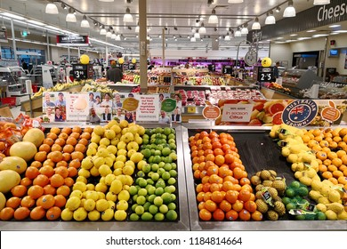 PERTH, AUSTRALIA - JUNE 16, 2018: Fresh fruits and vegetables on the shelf in Woolworths supermarket. Woolworths is an Australian supermarket/grocery store chain owned by Woolworths Limited.