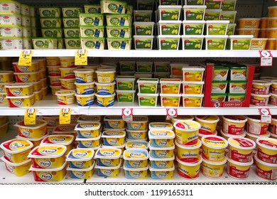 PERTH, AUSTRALIA - JUNE 16, 2018: Various brand of Vegetable and Olive Oil Spread on store shelf in Coles supermarket. Coles is an Australian supermarket, retail and consumer services chain.