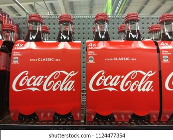 PERTH, AUSTRALIA - JUNE 19, 2018: Coca Cola bottle drink on display in a grocery store. Coca Cola Company is leading manufacturer of soda drinks in the world.