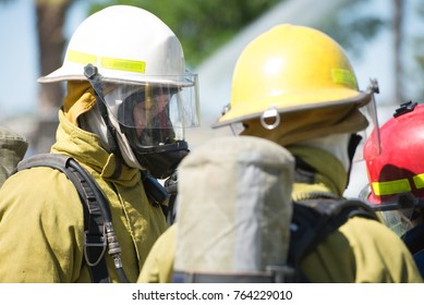 Perth, Australia, November 26, 2017: Firefighters of emergency response team wearing protective clothes, including oxygen mask and helmet, preparing for rescue service.
