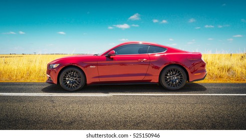 PERTH, AUSTRALIA - November 8, 2016 : Ford Mustang GT parked on road side with field of golden wheat background .