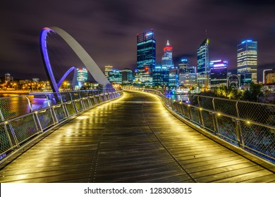 perth, australia - october 18, 2018: elizabeth quay bridge and skyline of perth with skyscrapers at night