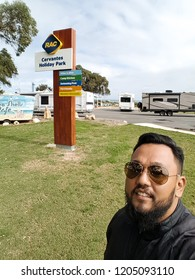 Perth, Australia - September 1, 2017: Asian bearded guy selfie with the motorhome campsite RAC Cervantes..