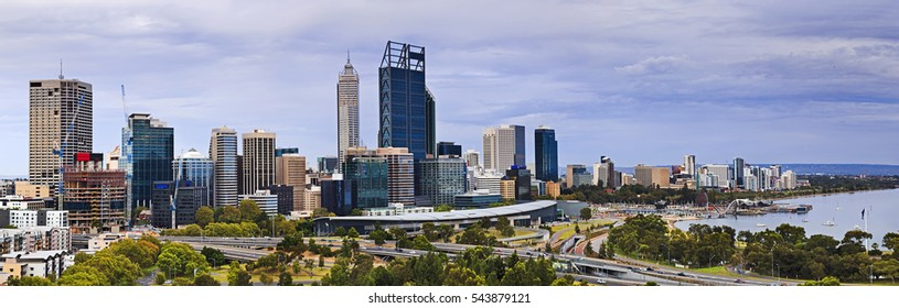 Perth city CBD wide panorama from Kings park elevated lookout on a cloudy summer morning. Skyscrapers and business towers of Australian mining capital at Swan River.