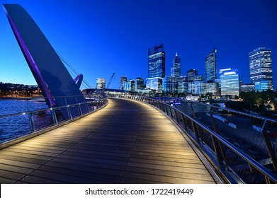 Perth financial district skyline as view from Elizabeth as view from Elizabeth Quay Pedestrian Bridge at night.