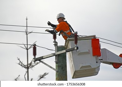 PERTH - JUNE 09 2020:Australian female electricity worker fixing power line. Women comprise 47.0% of all employed persons in Australia
