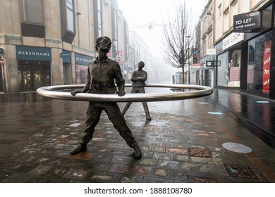 Perth, Perthshire, Scotland - January 06 2021: Images of Perth, Scotland on a foggy morning. Standing men statue on High Street.