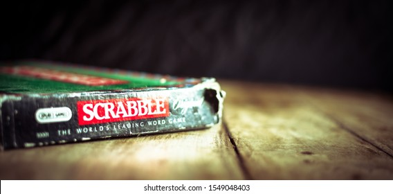 Perth, Scotland - 31 October 2019: Scrabble Board Game   Old Scrabble Box on Vintage Wooden Table