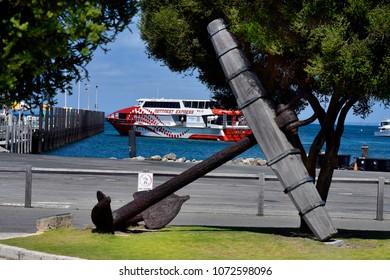 PERTH, WA, AUSTRALIA - NOVEMBER 27: Old anchor and ferry to Perth on jetty in Rottnest Island, on November 27, 2017 in Perth, Australia