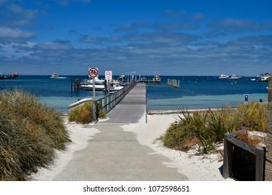 PERTH, WA, AUSTRALIA - NOVEMBER 27: Ferry to Perth and yachts on jetty in Rottnest Island, on November 27, 2017 in Perth, Australia