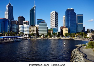 PERTH, WA, AUSTRALIA - NOVEMBER 27: Skyline from Perth on Swan river with different buildings, carousel and Spanda sculpture on Elizabeth Quay Esplanade, on November 27, 2017 in Perth, Australia