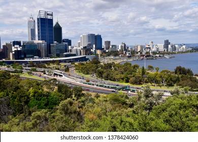 PERTH, WA, AUSTRALIA - NOVEMBER 29: cityscape from Kings Park with swan River, Elizabeth Bridge, Spanda sculpture and skyscrapers, on November 29, 2017 in Perth, Australia