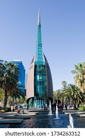 """Perth, W.A Australia - October 6th, 2012. Tourists enjoying the park and water features of the Bell Tower. The Bell tower contains the historic """"12 Bells of St. Martin in the Fields"""""""