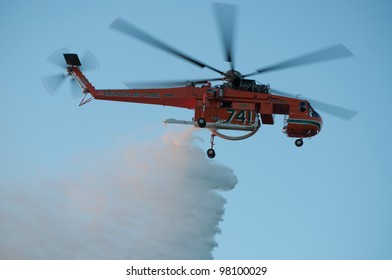 PERTH, WA - MARCH 17: Fire and Emergency Services Authority of Western Australia (FE SA) helicopter dumps water on bush fire at Bold Park, March 17, 2012 in Perth, Western Australia