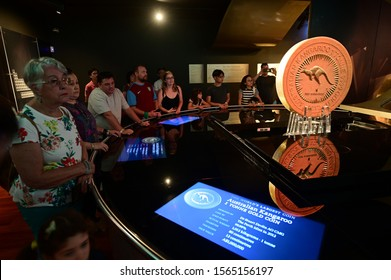 PERTH, WA - NOV 17 2019:Visitors at Perth mint looking at Aussie one-tonne gold coin the biggest and heaviest gold coin in the world. Made from 99.99 per cent pure gold and measures 80cm x 13cm.