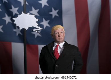 Perth, Western Australia - 30th July 2017: plastic or fake Donald trump with American flag in background and blank paper speech bubble