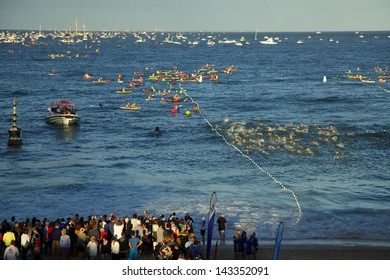 PERTH, WESTERN AUSTRALIA - FEBRUARY 23 : Swimmers and boats start the challenging Rottnest Channel Swim on 23 February, 2013 at Cottesloe Beach, Perth. The 20 km race ends at Rottnest Island.