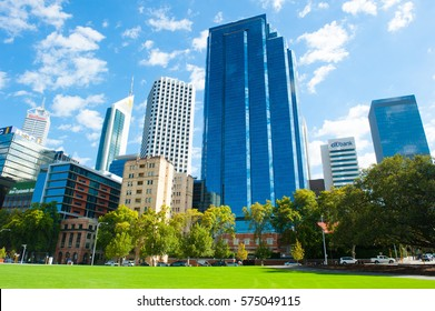 Perth, Western Australia - February 3, 2017: Panoramic view of Perth skyline, capital of Western Australia, headquarter for many mining and banking companies, with green lawn and park in foreground.