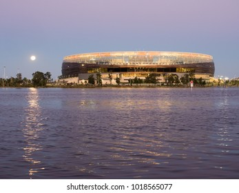 Perth, Western Australia - January 31, 2018:  Moon rising over Perth Optus Stadium and the Swan River.