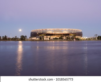 Perth, Western Australia - January 31, 2018:  Moon rising over Perth Optus Stadium and the Swan River