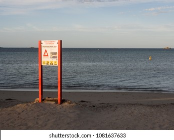 PERTH, WESTERN AUSTRALIA - MARCH 11, 2018: Danger sign for the sandbar to Penguin Island.  Visitors are urged to use the ferry instead.