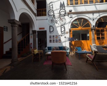 Peru, Cusco - September 18, 2019 - Selina Plaza de Armas Hostel interior living room with good mood sign and different color chairs