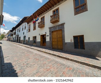 Peru, Cusco - September 18, 2019 - Selina Plaza de Armas Hostel exterior, colonial balconies and flags