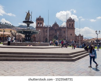 Peru, Cusco - September 28, 2019 - Cathedral and statue at plaza de armas