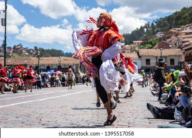 Peru, Cuzco, 2nd of Mai 2019, traditional dances for the Easter Parade on the Plaza de Armas. Dancer wear colourful costumes and head covers.