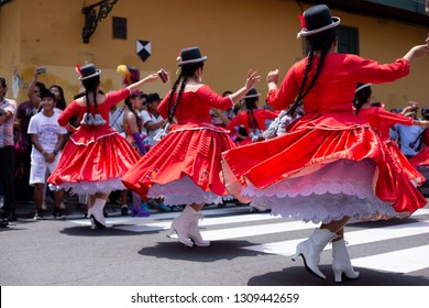 PERU, FEB 03, 2019: dancer in Festival of the Virgen de la Candelaria in Catedral of Lima, typical peruvian dance. Peruvian women with typical red dresses.