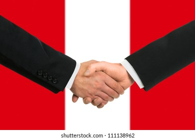 The Peru flag and business handshake