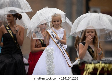 Peru, Indiana, USA - July 21, 2018 Under heavy rain The Beauty queens going down the road at the Circus City Festival Parade