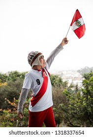 PERU, JUN 14, 2018: Peruvian child using the t-shirt of the peruvian selection and flag of peru.