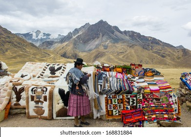 PERU - NOVEMBER 6, 2010: Unidentified Peruvian woman in traditional clothes works at the local market in Peru, Nov 6, 2010. Over 50 per cent of people in Peru live below the the poverty line.